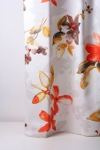 Плътна завеса с цветя в оранжево и кафяво
